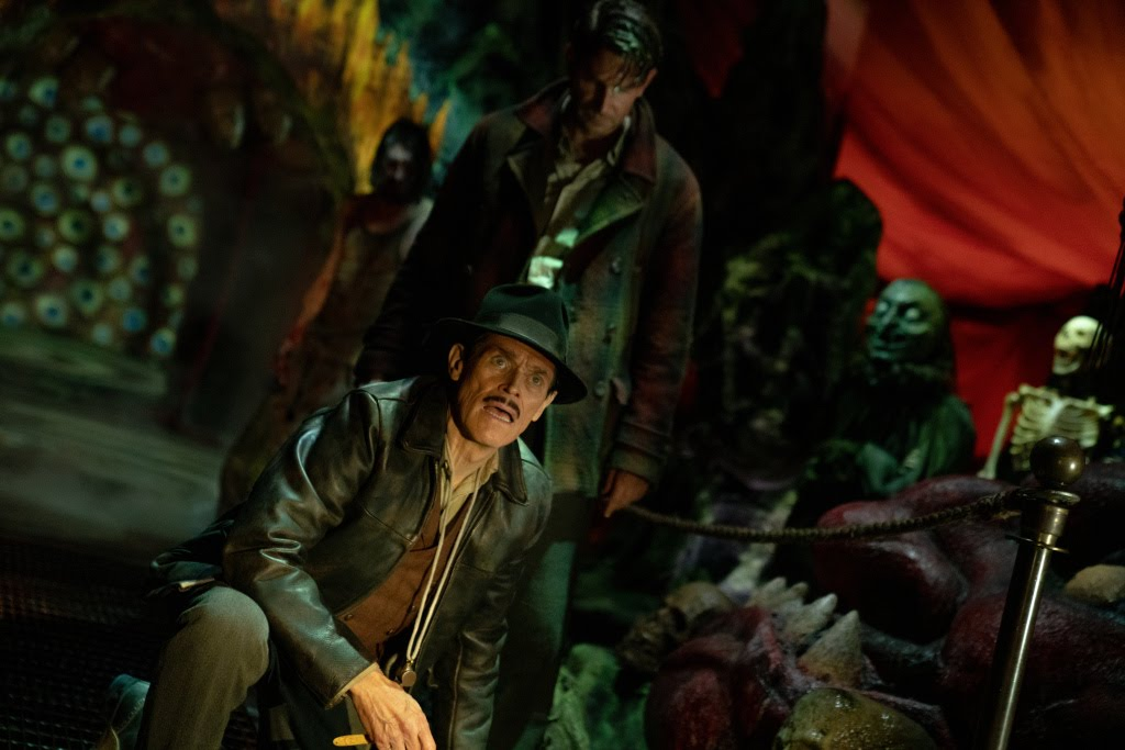 [Nightmare Alley Movie Still] Willem Dafoe as Clem Hoately, proprietor of a less-than-ethical traveling carnival, and Cooper as Stanton.